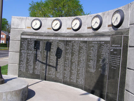 "The ""Friends Wall & World Clock"" stands next to the Boulevard of Nations. The granite wall displays the names of alumni and friends who donated to the International Plaza project."